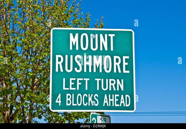 Traffic sign to Mount Rushmore National Memorial 4 blocks ahead - Stock Image