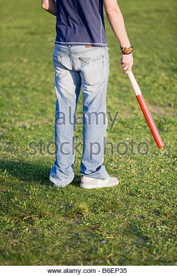 Guy with baseballbat - Stock Image