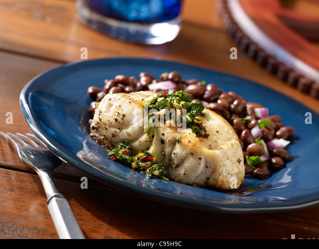 Sea bass served with beans - Stock Image