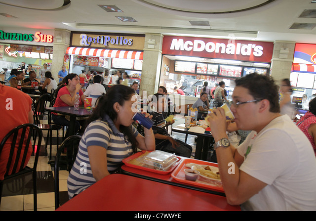 Managua Nicaragua Metrocentro shopping center centre mall food court chain restaurant McDonald's hamburgers - Stock Image