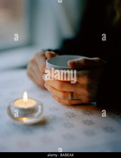 A woman holding a cup of tea Sweden - Stock-Bilder