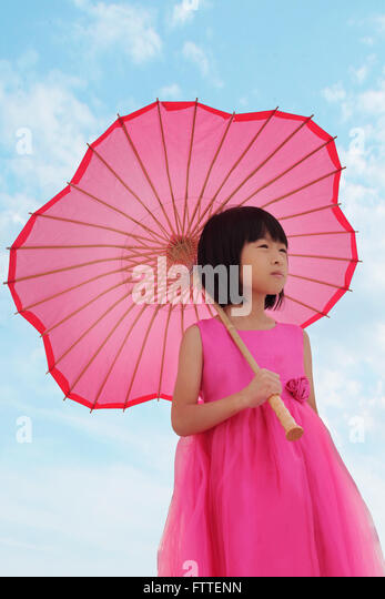 Asian girl in pink dress - Stock Image