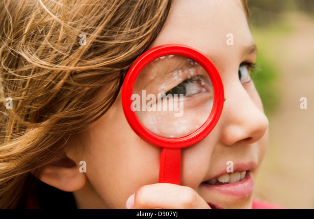 Portrait of girl with magnifying glass - Stock-Bilder