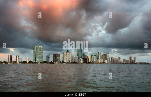 Miami cityscape skyline at dawn sunrise with dark clouds, Florida, USA - Stock Image