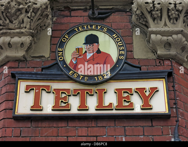 One of Tetleys Housing  estd 1822 Tetley Brewery huntsman sign on a wall of a pub in Liverpool - Stock Image