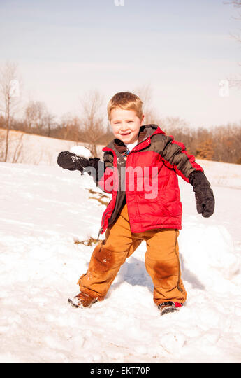 boy ready to  throw snowball - Stock Image