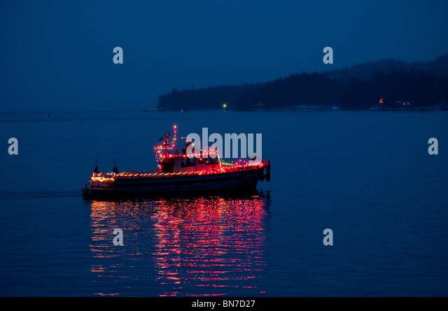 City of Ketchikan fire boat decorated for the Holiday Boat Parade, Alaska, Winter - Stock Image