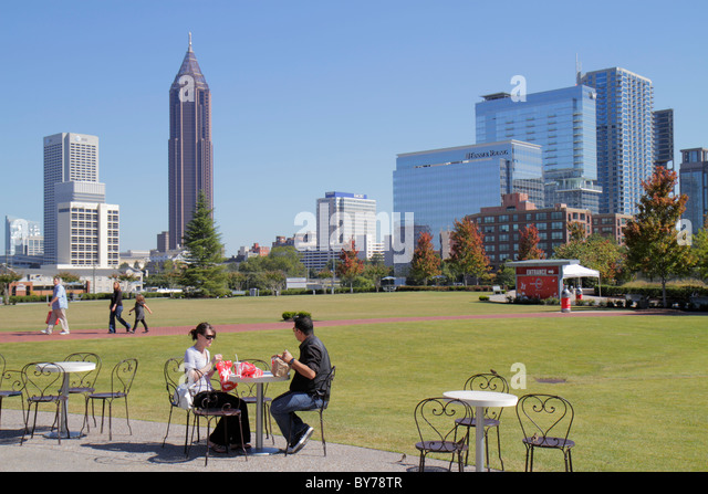 Atlanta Georgia downtown Pemberton Place World of Coca-Cola lawn skyline building man boy Bank of America Tower - Stock Image