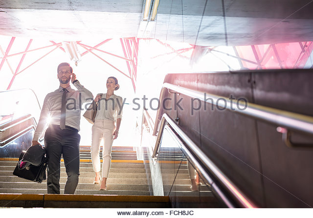 Poland Warsaw two business people walking downstairs - Stock Image