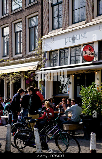 Bar with people drinking, Amsterdam, Netherlands - Stock Image