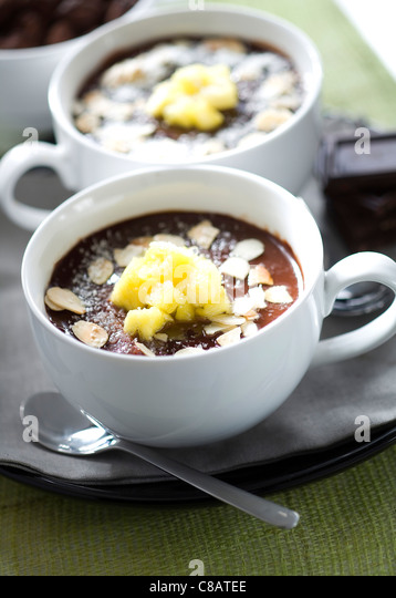 Chocolate cream dessert with almonds,pineapple and coconut - Stock-Bilder
