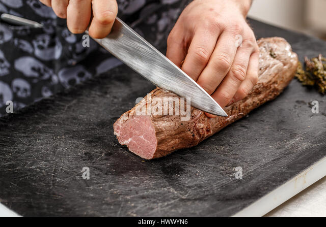chef knife meat stock photos chef knife meat stock images alamy. Black Bedroom Furniture Sets. Home Design Ideas