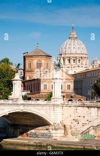 view of the River Tiber, the Ponte Vittorio Emanuele II and St. Peter's Basilica in Vatican City Rome , Italy - Stock Image