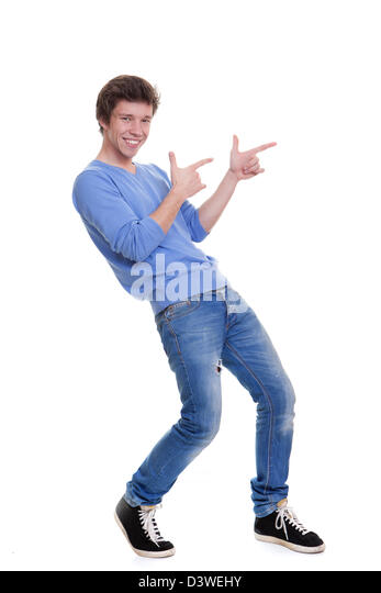 happy teen pointing at copy space - Stock Image