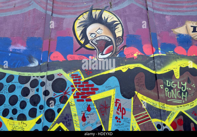 Face on International Peace Wall,Cupar Way,West Belfast , Northern Ireland, UK - Stock Image