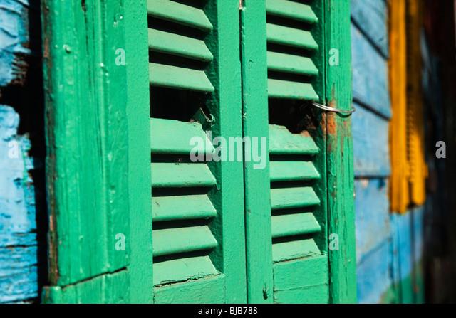 Green window shutter in La Boca, Buenos Aires, Argentina - Stock Image