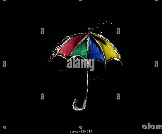 A colored umbrella made of water on black. - Stock Image