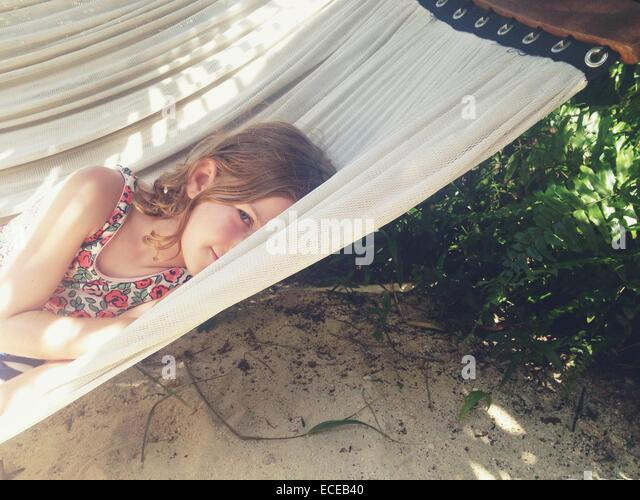 Shy girl on hammock - Stock Image