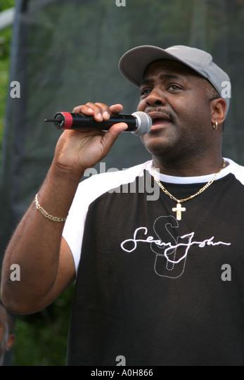 Coconut Grove Florida Grand Avenue Bahamas Goombay Festival Black male man singer entertainer microphone - Stock Image