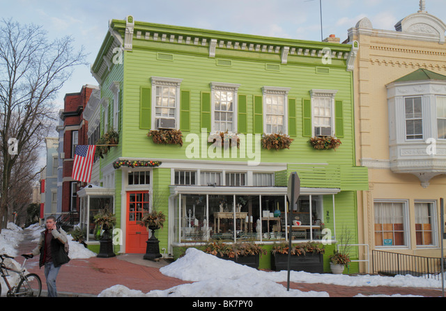 Washington DC Georgetown O Street historic neighborhood college town gentrification corner business antique store - Stock Image