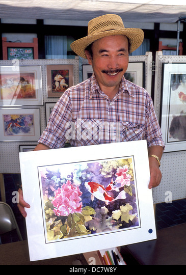 An artist shows off his watercolor paintings at this Little Tokyo sidewalk booth in Japanese Village Plaza in downtown - Stock-Bilder