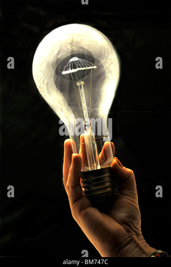 Light bulb in hand - Stock Image