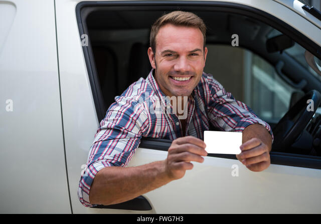 Young man showing his drivers license - Stock Image