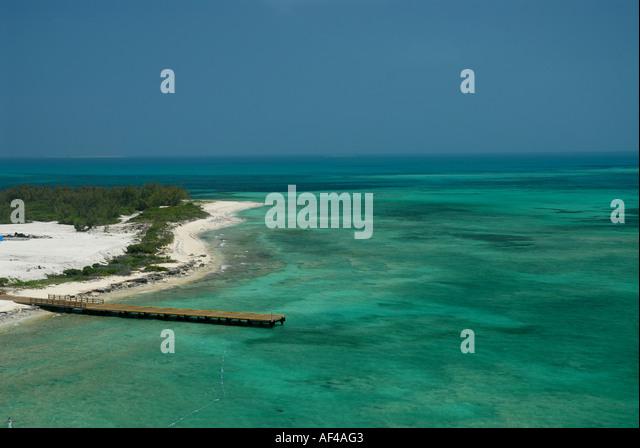 Grand Turk Island beach dock clear water - Stock Image