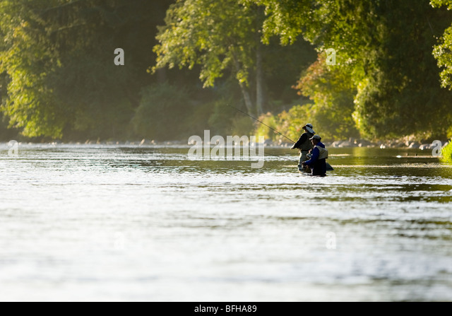 Flyfishermen in the Campbell River, fish the pools below Elk Falls.  Campbell River, Vancouver Island, British Columbia, - Stock Image