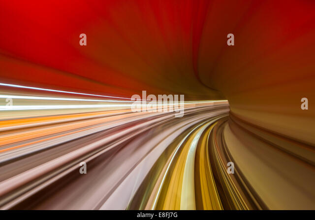 Train moving through railway tunnel - Stock Image