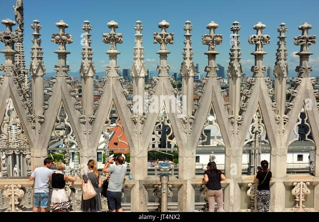 Tourists on the viewing platform at the top of The Duomo (Cathedral), Piazza del Duomo, Milan, Lombardy, Italy, - Stock Image