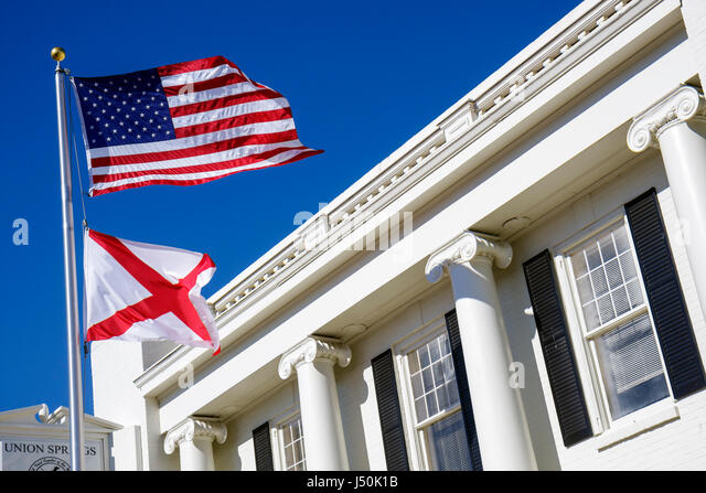 Alabama Union Springs Prairie Street City Hall local government flag Doric columns white building - Stock Image