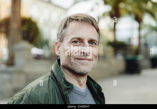 Spain, Canary Islands, Gran Canaria, portrait of smiling mature man - Stock-Bilder