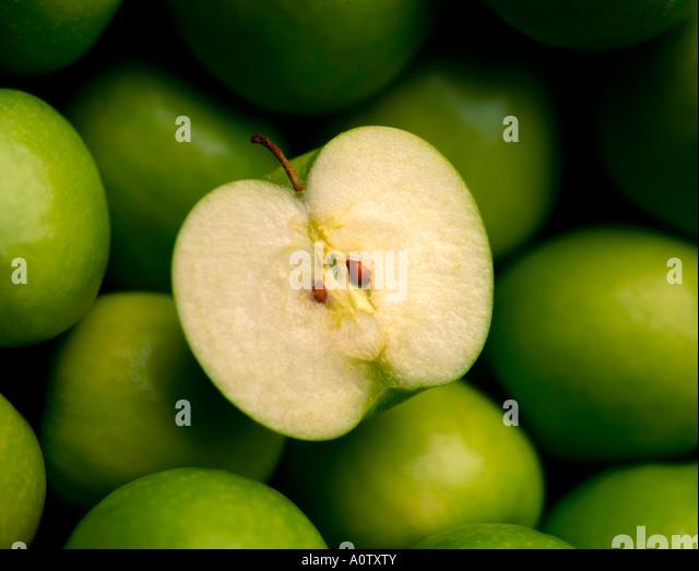 CUT GREEN APPLES - Stock Image