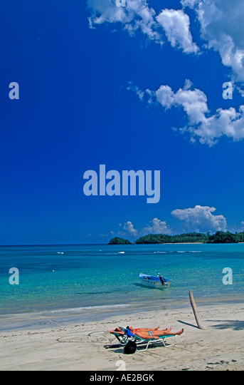 Couple on beach Samana Peninsula Dominican Republic - Stock Image