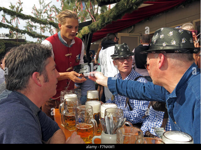 Paying for beer at Oktoberfest,Munich,Bavaria,Germany - Stock Image