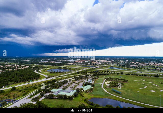 Florida Port Saint St Lucie West severe weather thunderstorm storm rain aerial overhead view bird's eye above - Stock Image