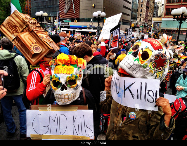 New York City Demonstration against GMO foods, Day of the Dead masks, GMO KIlls - Stock Image