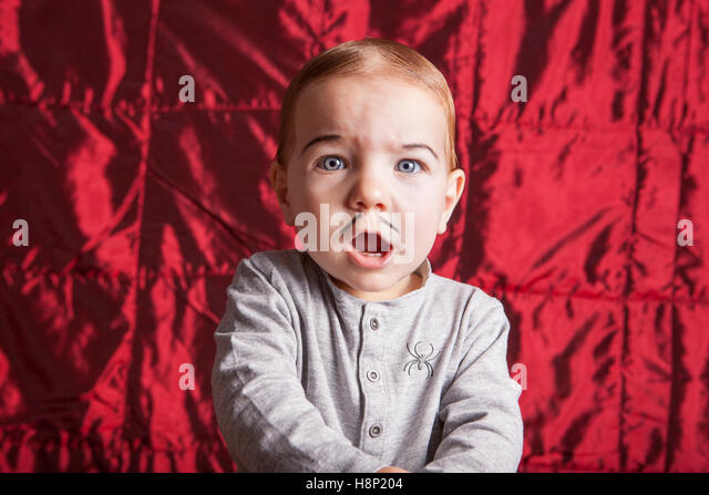 Portrait of a little boy dress up for halloween party. He has a surprised expression - Stock Image