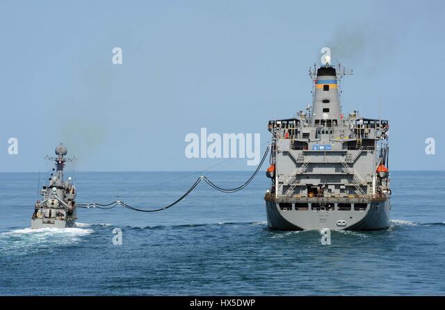 Military Sealift Command fleet replenishment oiler USNS Pecos (T-AO-197) and Republic of Korea navy patrol combat - Stock Image