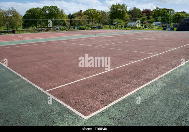 Abandoned, empty municipal tennis courts, England, UK - Stock Image
