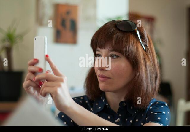 Woman Taking Selfie with Smartphone - Stock-Bilder