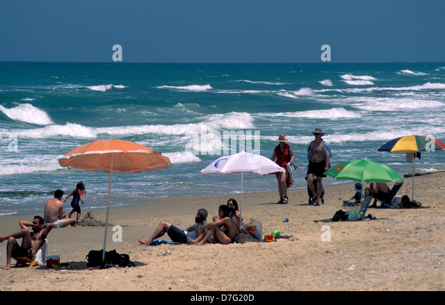 bathers on the beach of sidney ali in herzliya - Stock Image
