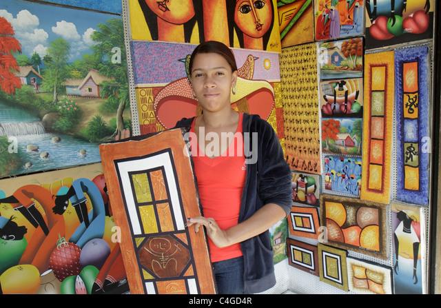 Santo Domingo Dominican Republic Ciudad Colonia Mercado Modela market shopping folk art paintings canvas Hispanic - Stock Image