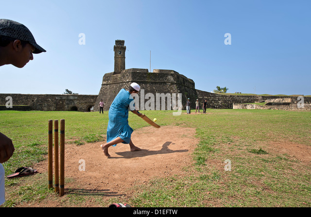 Boys playing cricket.Galle.Sri Lanka - Stock Image
