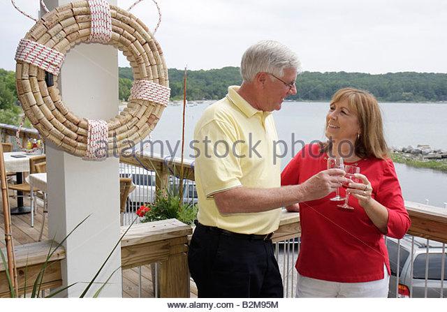 Michigan Traverse City Leelanau Peninsula Omena Bay Leelanau Cellars winery man woman couple outdoor veranda romance - Stock Image