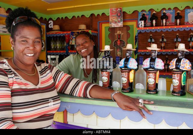 Sint Maarten Great Bay Philipsburg Dutch Black female bar rum liqueur - Stock Image