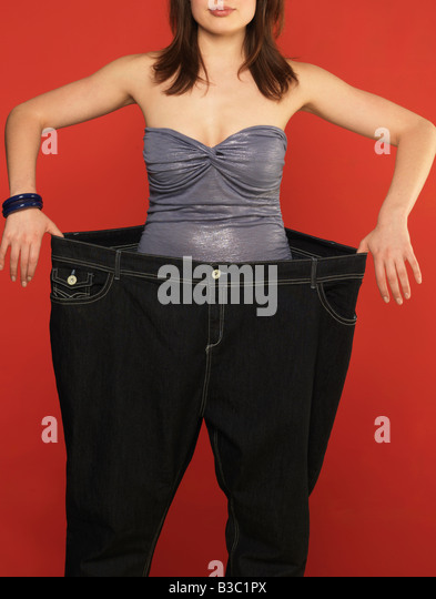 A woman wearing oversized trousers - Stock Image