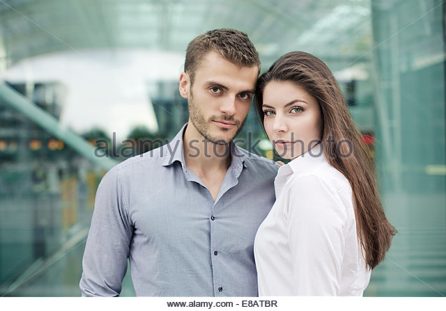 Young couple looking at camera, portrait - Stock-Bilder