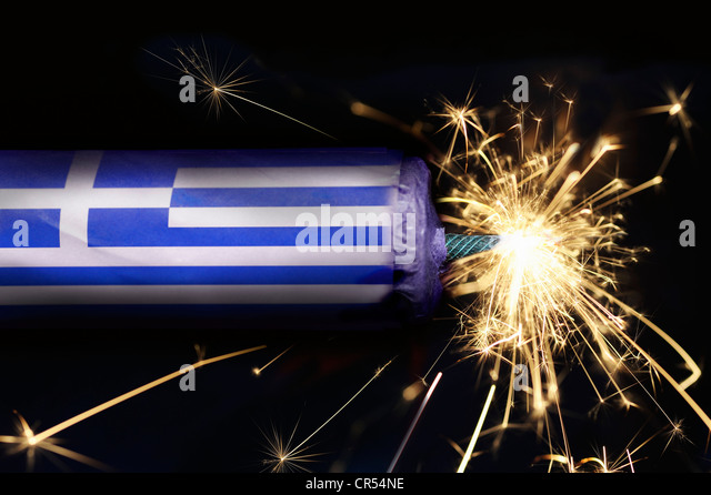 Stick of dynamite with the Greek national colours with a burning fuse, symbolic image of the impending bankruptcy - Stock Image